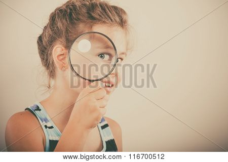 Little Girl Kid Looking Through Magnifying Glass.