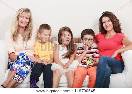 Happy Family. Mothers And Kids On Sofa At Home.