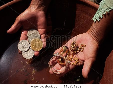 Jewelry and old Dutch coins are washed in holy water at a Balinese-Hindu baby-naming