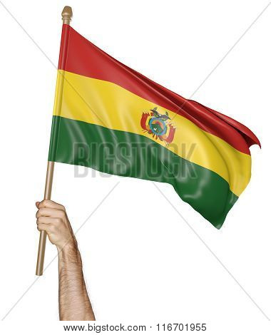 Hand proudly waving the national flag of Bolivia