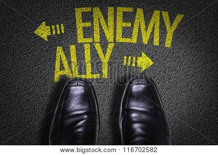 Top View of Business Shoes on the floor with the text: Enemy - Ally