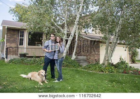 Couple outside new home