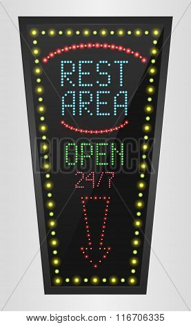 Retro sign with blue lights and the word rest area