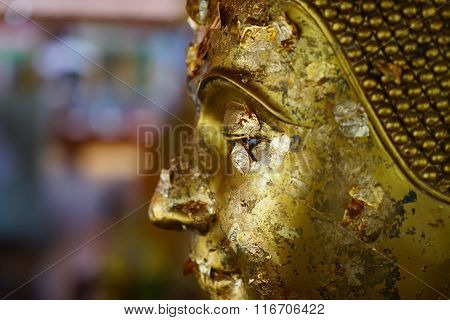 Gold Leaf On The Eyes Of Buddha Statue