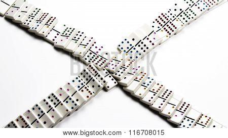 Fallen White Ceramic Dominoes In Crossing Pattern
