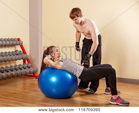 Trainer Explains Girl Exercise On Fitball.
