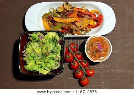 Roasted peppers and Guacamole and salsa