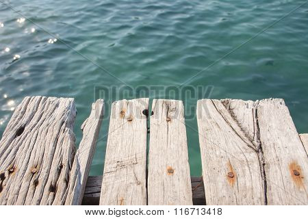 Summer, Travel, Vacation And Holiday Concept - Beautiful Wooden Pier At A Beach In Koh Wai Island, T