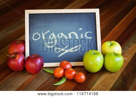 Apples, Tomatoes, Pea Pods And Blackboard Composition