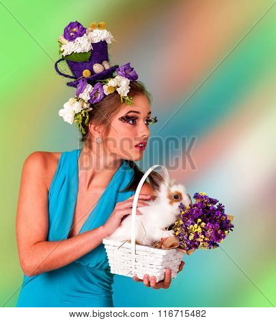 Woman with false eyelashes  and flowers in hair holding easter bunny.