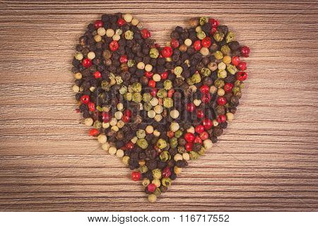 Vintage Photo, Heart Of Fresh Colored Pepper On Wooden Background