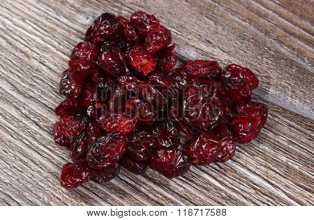Heart Of Red Cranberries On Wooden Table