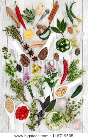 Large health food herb and spice seasoning selection over distressed white wood background.