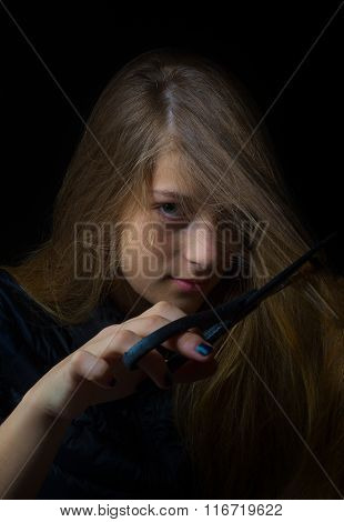 Low-key Young Girl Ironic Portrait Cutting Hair With Scissors