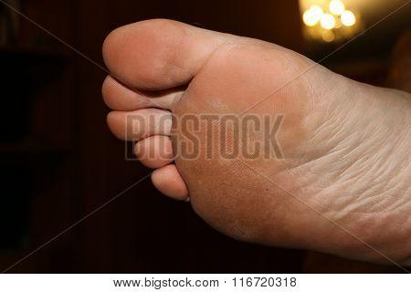 Big pink foot and fingers of big men