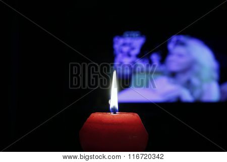 The red flame of the red candle