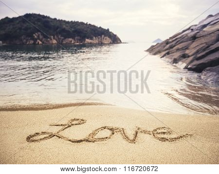 Love Handwriting On Sand Beach Holiday Background