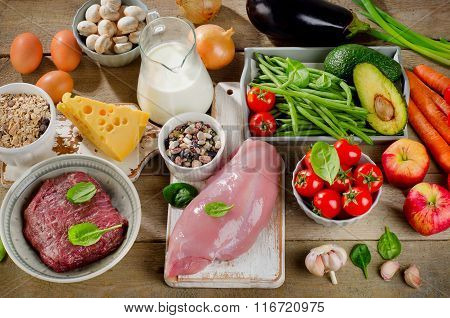 Assortment Of Fresh Vegetables And Meats For Healthy Diet On A Rustic Table.