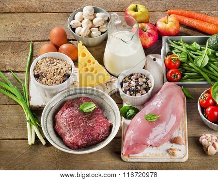Assortment Of Fresh Vegetables And Meats For Healthy Diet On A Wooden Background.