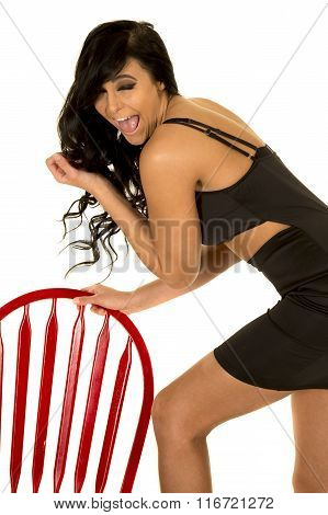 Woman In Black Top Red Chair Laugh