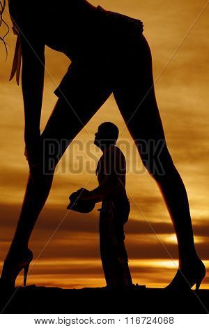 Silhouette Of Woman In Short Skirt Butt Out Close Cowboy