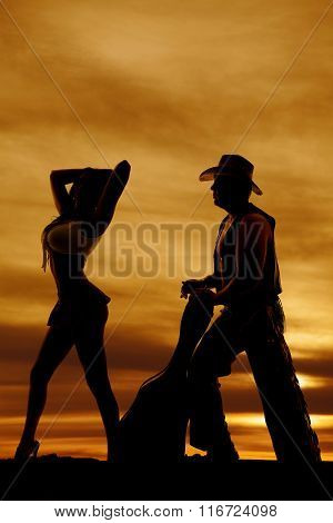 Silhouette Of Woman In Short Skirt Side Hand By Head With Cowboy And Guitar