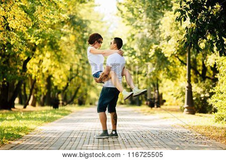 Hipster Young Couple Having Fun Together On A Summers Day In Park.