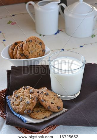 Glass Of Milk Accompanied By Biscuits