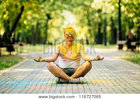 Young Hipster Man Laughing Happily At Camera In The Park On Holi Color Festival.