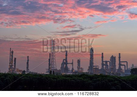 Twilight Of Oil Refinery Plant On Skies Exploded Background.