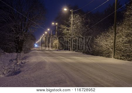 Winter-time rural road covered with snow