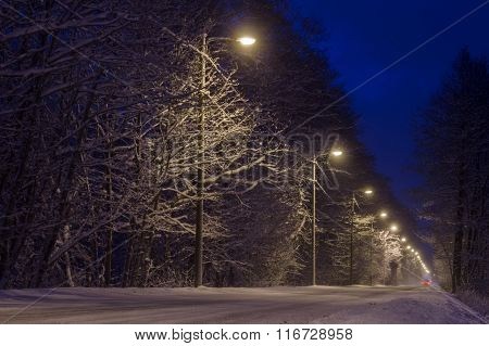 Countryside Road Covered With Snow By Night
