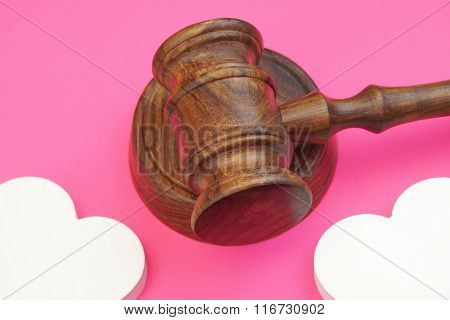 Legalities Of Divorce Concept. Judges Gavel And Two Hearts Isolated
