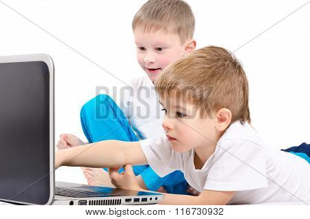 Two children looking on laptop screen