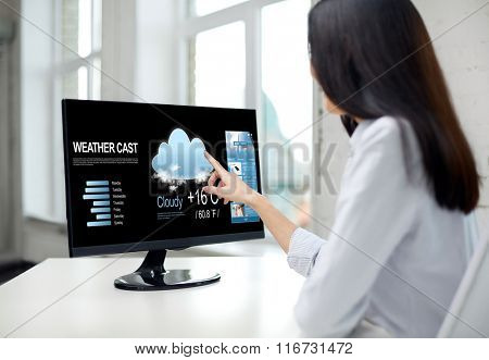 close up of woman with weather cast on computer