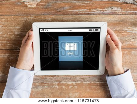 close up of hands with email message on tablet pc