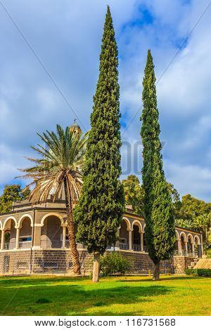 Israel, the shores of Lake Kinneret. Catholic monastery and a small church Mount Beatitudes. Dome and colonnade surrounded by cypress