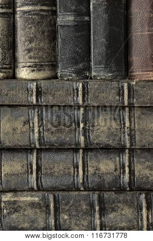 Old Shabby Books With Black Leather Cover Vertical Background