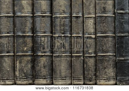 Old Shabby Books With Black Leather Cover Horizontal Background