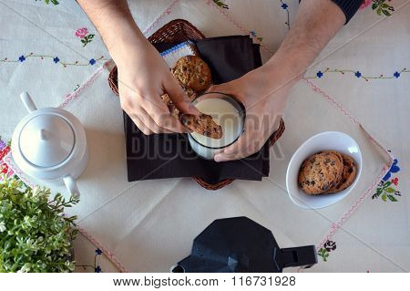 Hand Dunking A Cookie