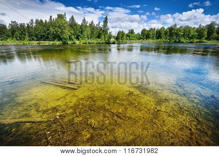 A Quarry Lake In Latvia With Clear Water