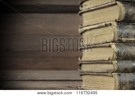 Old Shabby Books In Stack On The Wood Horizontal Background