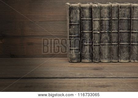 Seven Old Shabby Books With Black Leather Cover Horizontal Background