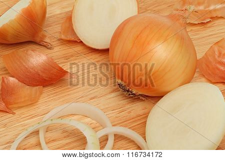 Top View Of Raw Onion Lying On Cutting Board
