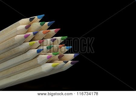 Large Group Of Colored Pencil Isolated On Black Background