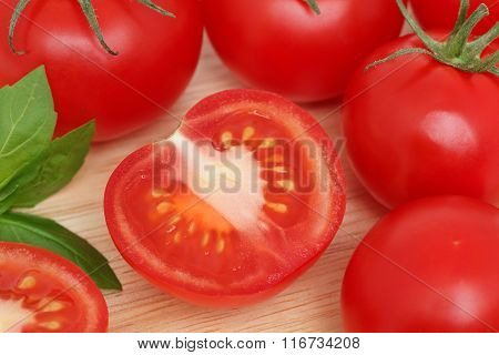 Top View Of Ripe Tomatoes Lying On Wooden Board