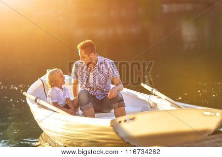 Dad and son in boat outdoors