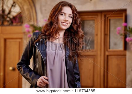 Fashionably jacket woman on the streets of a small Italian town