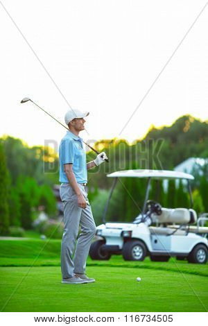 Young golfer on the golf course