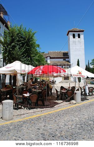 Pavement cafe and church, Granada.